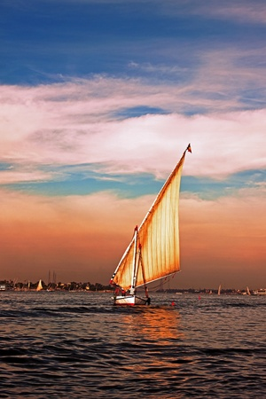 Feluka in navigation on the River Nile, Luxor Egypt photo