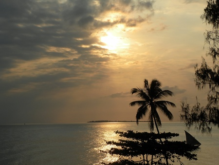 View a spectacular sunset over the sea of ​​Zanzibar, Tanzania photo