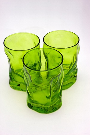 three glasses of green glass isolated on white background photo