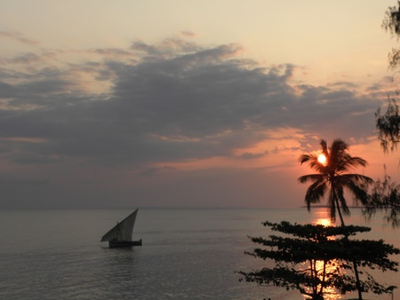 View a spectacular sunset over the sea of Zanzibar, Tanzania Stock Photo