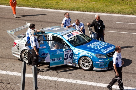 Cars and technicians on the grid at Monza circuit, the Rally of Monza, Monza Italy