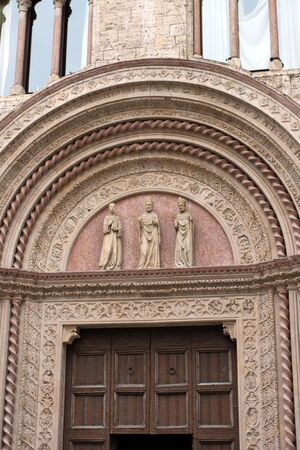 Entrance door to a historic palace in the center of Perugia, Italy