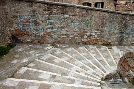 Steps in against the city of Perugia, Umbria - Italy photo