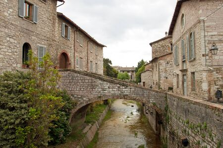 River in the historic center of Gubbio, Umbria - Italy photo