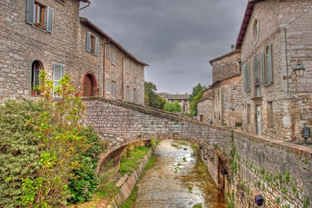 River in the historic center of Gubbio tonemapped, Umbria - Italy photo