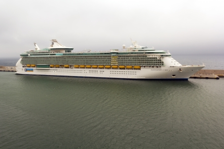 Indipendence of the Seas cruise ship docked at Genoa harbor, Italy. The vessel is operated by the Royal Caribbean cruise line. Editorial