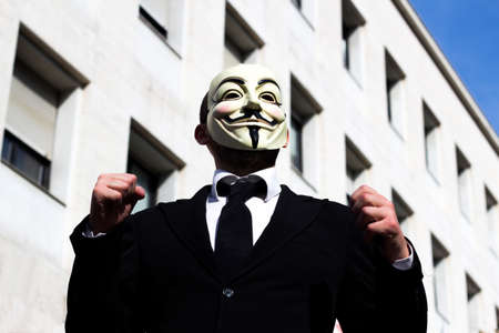 anonymus: man with mask for vengeance at the palace of work