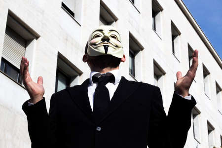anonymus: the business man with mask loser Stock Photo