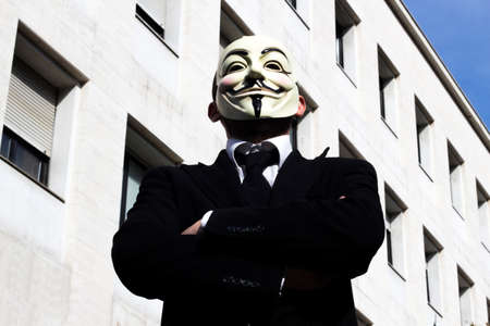 inhibited: Anonymus business man head-on, with mask Stock Photo