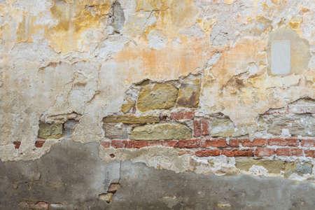deterioration: Deterioration of old wall, brick broken