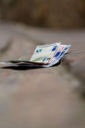 pedestrian walkway: euro bill lost in the pedestrian walkway