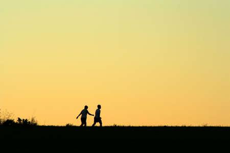 Friends walking, dawn 版權商用圖片