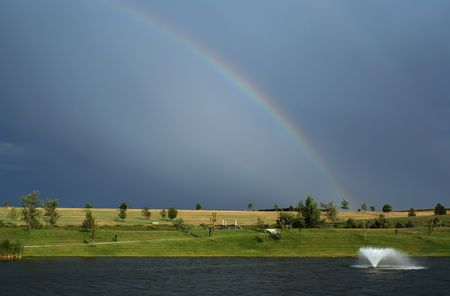Rainbow and fountain; St. Benedict Retreat Center Фото со стока