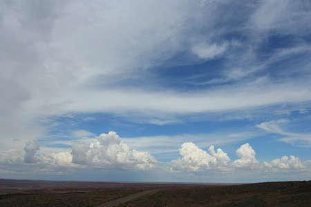 cirrus: cirrus and cumulus clouds over painted desert