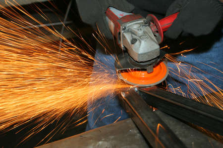 welder at work, grinding