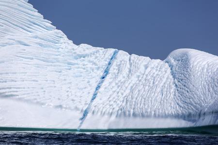 iceberg with blue streak near St  Anthony, Newfoundland