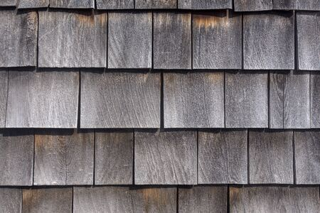 rows of weathered wood shingles, barn siding