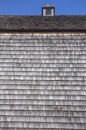 weathered wood shingles on barn siding and roof with cupola; Green Gables barn, Cavendish, Prince Edward Island
