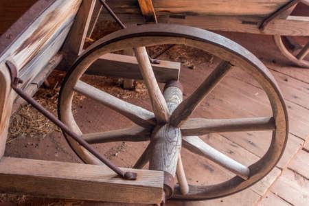 wood wheel on vintage wheelbarrow