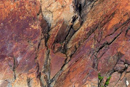 red fractured rocks on Fogo Island, Newfoundland Imagens