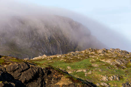 fog covering Brimstone Head, Fogo Island, Newfoundland