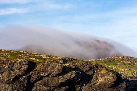 fog on Brimstone Head, Fogo Island, Newfoundland Stock Photo