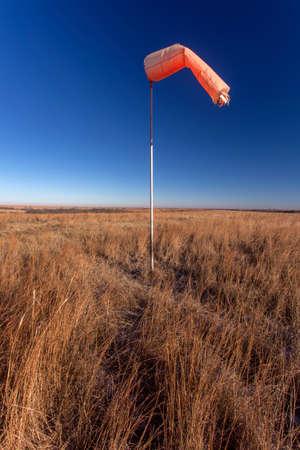 orange windsock at abandoned rural Kansas airstrip