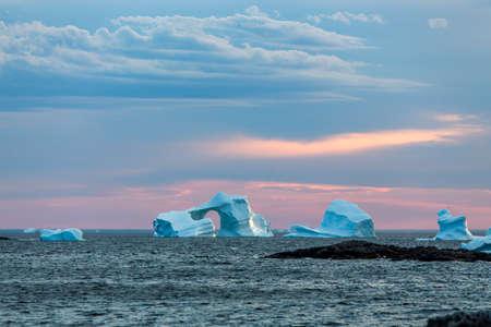 group of icebergs at sunset near Fogo Island, Newfoundland
