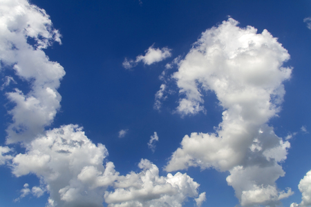 fluffy cumulus clouds and blue sky over Kansas