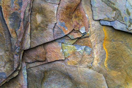 colorful rock face with layers and fractures, Newfoundland Archivio Fotografico