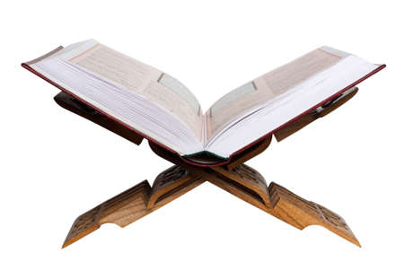 Holy Koran on the book rest. Isolated on the white background.