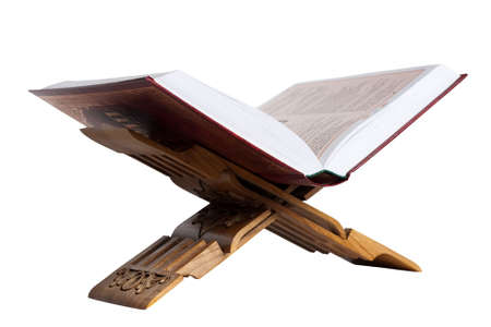 Holy Koran on the book rest. Isolated on the white background. photo