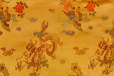 embroidered: Oriental background with embroidered ornament. Stock Photo