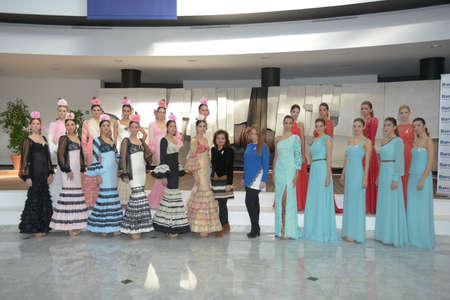 tractive: Perched Miss World Seville 2013 in flamenco and evening dresses in Seville, Spain