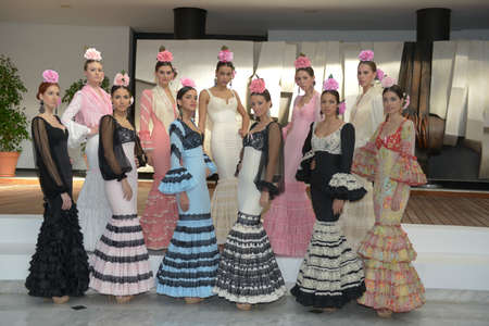 tractive: Perched Miss World Seville 2013 in flamenco dresses in Seville, Spain  Editorial