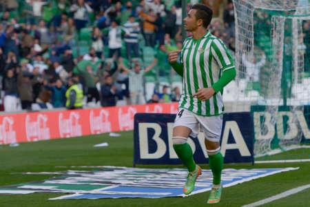 primer: SEVILLA, ESPANA, FEBRERO 2, 2014: Ruben Castro celebra su primer gol en el encuentro entre Real Betis y Espanyol correspondiente a la jornada 22 de la Liga BBVA 2013-2014 disputado en el estadio Benito Villamarin el 2 de febrero de 2014  en Sevilla, Espan Editorial