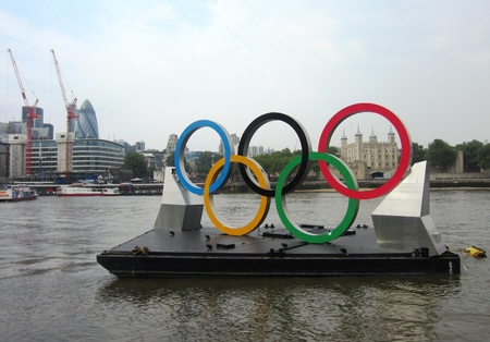 olympic rings: Tower of London and Olympic Rings on River Thames on Olympic Opening Day London 2012
