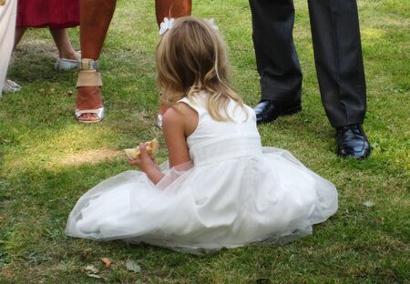 Child Bridesmaid At Wedding Garden Party Resting