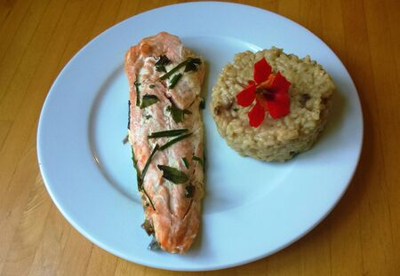 home cooked: Home cooked fresh salmon and rice with nasturtium on a white plate Stock Photo