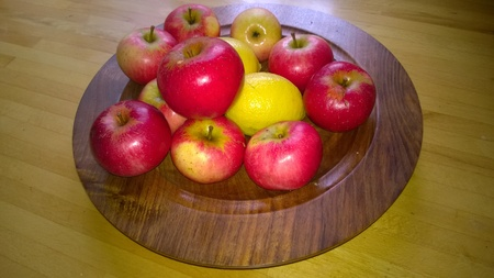 shiney: Wooden Plate of Red Apples and Lemons