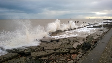 defenses: Waves Crash against the sea defenses at Lowestoft in Suffolk England