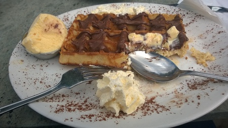 savour: A delicious plate of waffle,chocolate,ice cream and cream Stock Photo