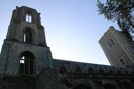 recently: A view looking upwards to the blue clear sky from below the ruined tower of the recently refurbished Wymondham Abbey in Norfolk England