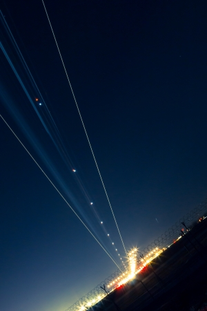 light trail: light trail of aircraft while landing Stock Photo
