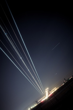 depart: light trail of aircraft while landing Stock Photo