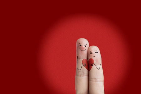 romantic couple: Finger art of a Happy couple. Lovers is embracing and holding red heart. Valentine card