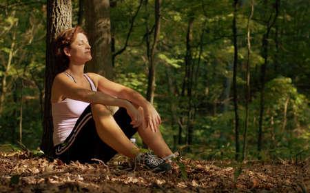 Mature woman runner resting.