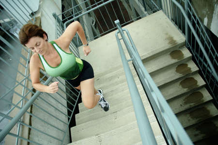 tiring: Mature woman runner in the city. Stock Photo