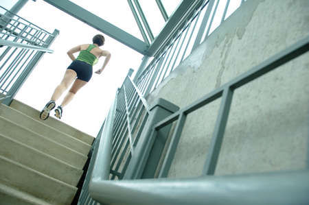 woman stairs: Mature woman runner in the city. Stock Photo
