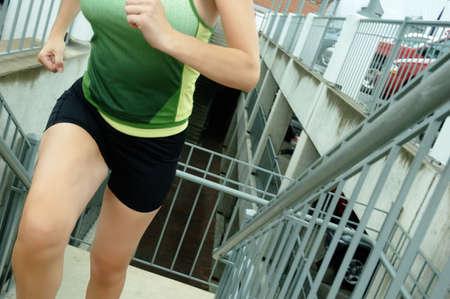 Mature woman runner in the city. Stok Fotoğraf